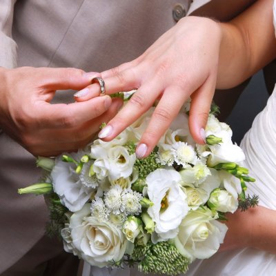 Husband Placing Wedding Ring On Wifes Finger